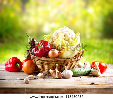 Vegetables . Fresh Bio Vegetable in a Basket. Over Nature Background #113430232