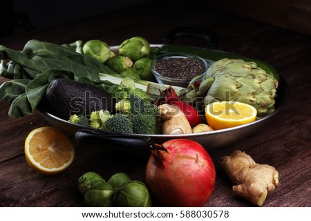 Vegetables, fruit, seeds, cereals, beans, spices, superfoods, herbs, condiment in silver pan for vegan, gluten free, allergy-friendly, clean eating and raw diet. - Shutterstock ID 588030578