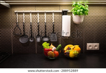 Vegetables, fruits and herbs in a contemporary kitchen.
