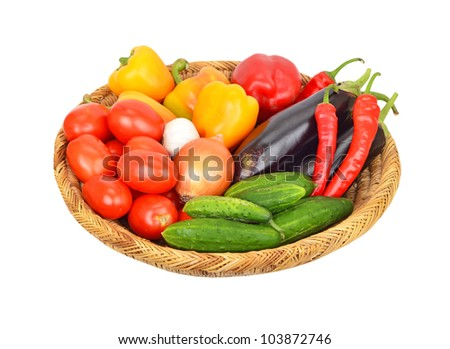 Vegetables in a wattled basket, isolated on white background