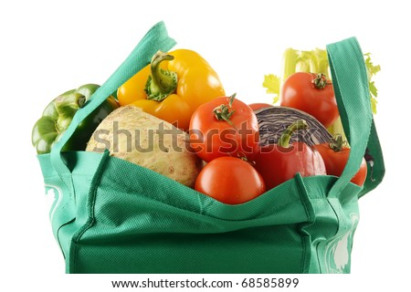Vegetables in shopping bag isolated on white