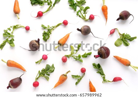 Vegetables isolated on white background. Food pattern of vegetables: carrots, radishes, beets, green tops. Top view.
