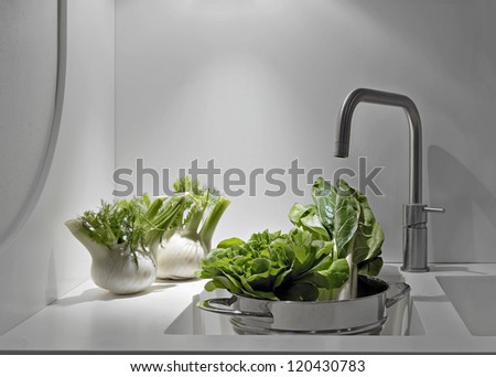 vegetables near to sink and stell taps