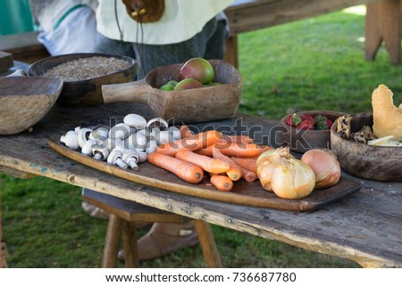 Vegetables on old table in old dishes #736687780