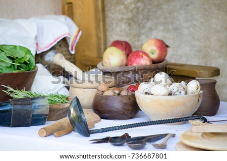 Vegetables on old table in old dishes #736687801