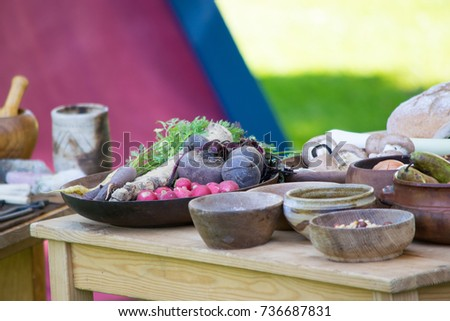 Vegetables on old table in old dishes #736687831
