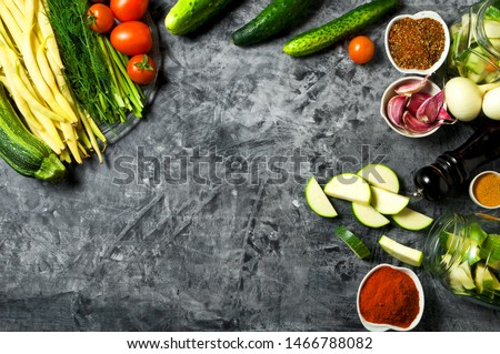Vegetables on the background. Fresh vegetables (cucumbers, tomatoes, onions, garlic, dill, green beans) on a gray background. Top view. Copy space #1466788082