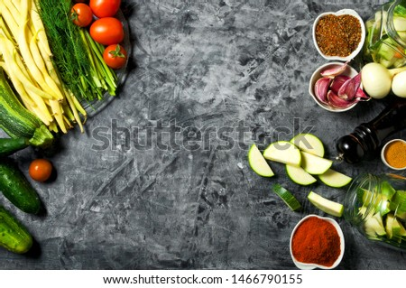 Vegetables on the background. Fresh vegetables (cucumbers, tomatoes, onions, garlic, dill, green beans) on a gray background. Top view. Copy space #1466790155