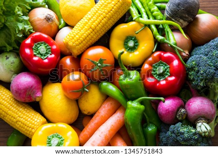 Vegetables on the black background. Organic foods and fresh vegetables. Cucumber, cabbage, pepper, salad, carrot, broccoli, lettuce and tomato on the table. #1345751843
