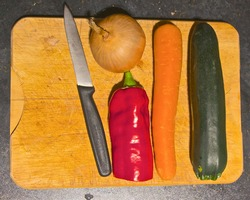 Vegetables on the chopping board getting ready for cooking
