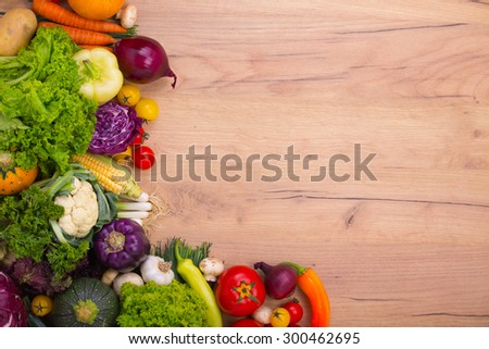 Vegetables on wood background with space for text  #300462695