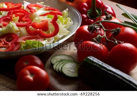 Vegetables stacked on table, still life, salad preparation