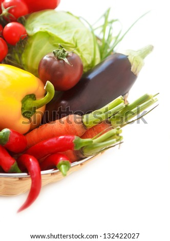 Vegetables still life on the white background with copy space - stock photo