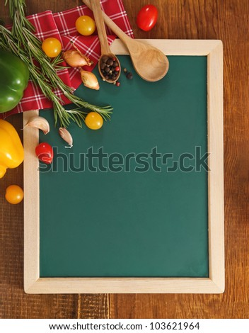 Vegetables still life with green board with copy space - stock photo