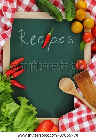Vegetables still life with recipes blank on checkered background
