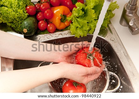 Vegetables washing, splashing water, fresh salad preparation