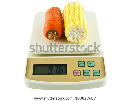 Vegetables Weighing Digital Scales On Isolated White Background