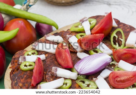 Vegetables with traditional salami on wooden plate Stock photo ©