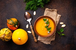 Vegetarian autumn  pumpkin cream soup with seeds