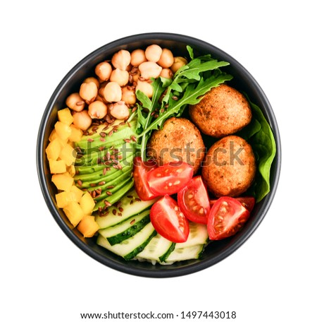 Vegetarian buddha bowl with cucumber, avocado, falafel, tomato and chickpeas isolated on white background, top view