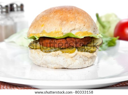 Vegetarian burger made from integral bred with  tofu cream, mustard,  sour cucumber and  lettuce