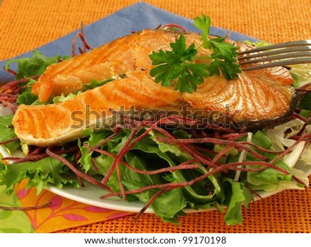 Vegetarian dish with salmon and vegetables