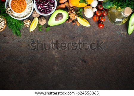 Vegetarian food background. Organic food for healthy vegan nutrition. Ingredients for cooking. Top view copy space stone table.