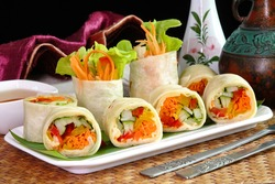 Vegetarian food : Hummus and vegetable wrapped with Tortillas. Tortillas-Hummus Fresh spring rolls , selective focus.