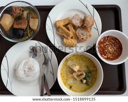 Vegetarian food in Vegetarian festival. Mix of vegetables hot pot.fried bean curd.Fermented rice flour noodles with vegetable green curry
