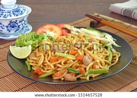 Vegetarian food : stir fried noodle with tofu, carrots and green vegetables. Chinese vegetarian noodle for vegetarian festival.