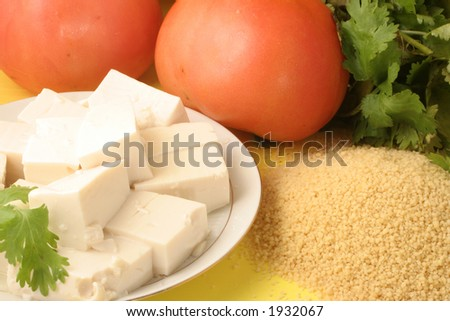 vegetarian food (tomato,tofu,parsley, and couscous)