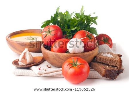 Vegetarian food, vegetables, herbs and bread closeup isolated