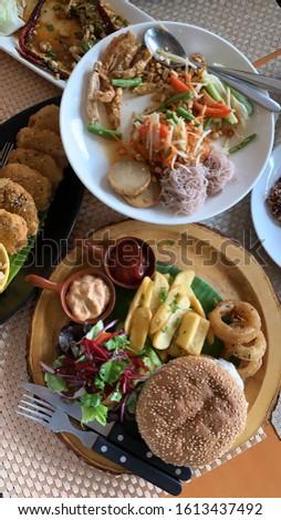 Vegetarian food : vegetarian burgers, Thai spicy green papaya salad, fried potato