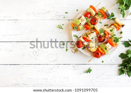 Vegetarian grilling. Vegetarian skewers with halloumi cheese and vegetables on white background, copy space. #1091099705