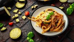 Vegetarian Italian Pasta Spaghetti alla Norma with eggplant, tomatoes, basil and parmesan cheese.