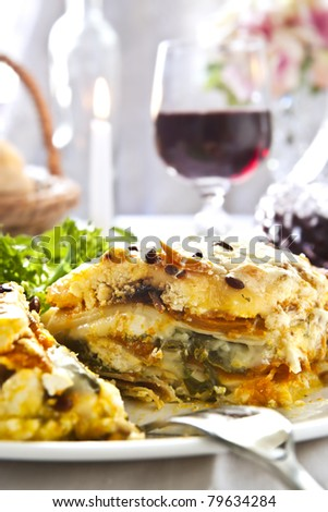 Vegetarian lasagne with a glass of red wine.