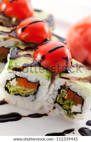 Vegetarian Maki Sushi -  Roll made of Tomato, Cucumber, Bell Pepper, Salad Leaf. Garnished with Cherry Tomato