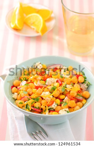 Vegetarian meal of chickpea with red peppers, radish, corn, onion and herbs - stock photo