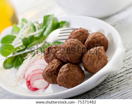 vegetarian meatballs with slice radish, soy sprout and salad