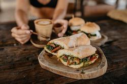 Vegetarian panini sandwiches with coffee