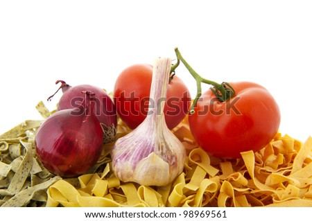 Vegetarian pasta ingredients with onions garlic and tomatoes