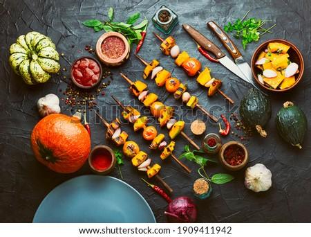 Vegetarian pumpkin and yellow tomato kebabs.Pumpkin fried on skewers.