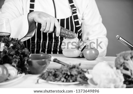 Vegetarian recipe concept. Vegetarian restaurant. Buy fresh vegetables grocery store. Hipster chief chef vegetarian cafe. Choose vegetarian lifestyle. Man cook hat apron hold fresh vegetables.