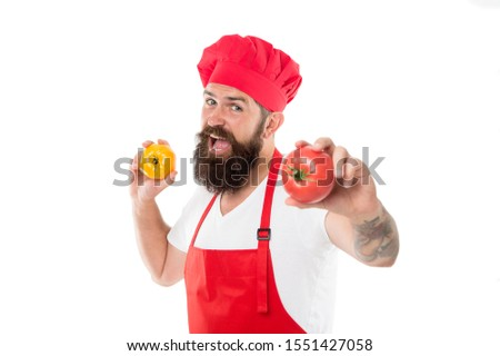 Vegetarian restaurant. Professional cook hold tomatoes in hands. Bearded man enjoy cooking vegetarian food. Vegetarian or meat-free diet. Vegan or vegetarian.