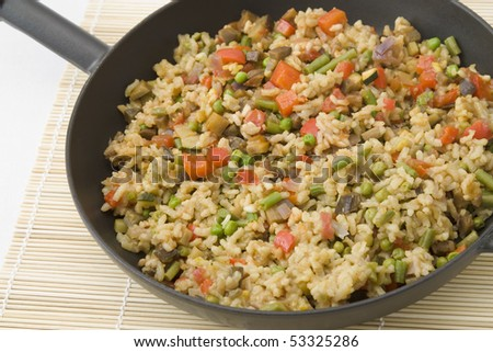 Vegetarian rice dish made from pepper, tomatoes, beans, peas, aubergines, courgette and onion which is in Spain also called paella.