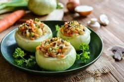 Vegetarian roasted kohlrabi stuffed with mushrooms, onion, eggs, and carrot