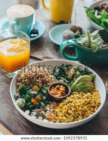 Vegetarian salad bowl with patties and greens, served with quinoa and couscous