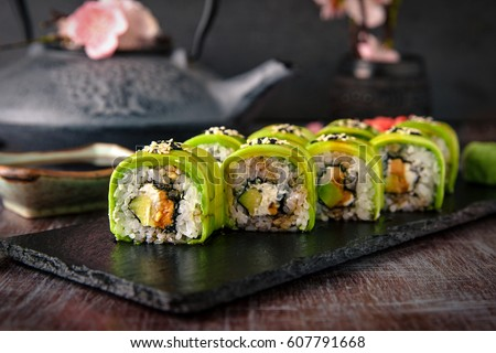 Vegetarian sushi rolls avocado with cream Philadelphia cheese, sesame, unagi sauce. Sushi menu. Japanese food.