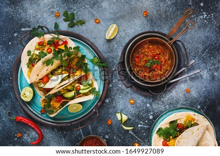 Vegetarian Tacos. Variety of vegetarian  tacos with vegetables, avocado, chili pepper, lentil, guacamole and spicy black beans. Top view, blank space