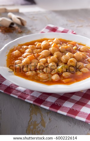 Vegetarian tasty spicy sweet potato chick pea wild carrot chili / posole / soup on a rustic concrete background